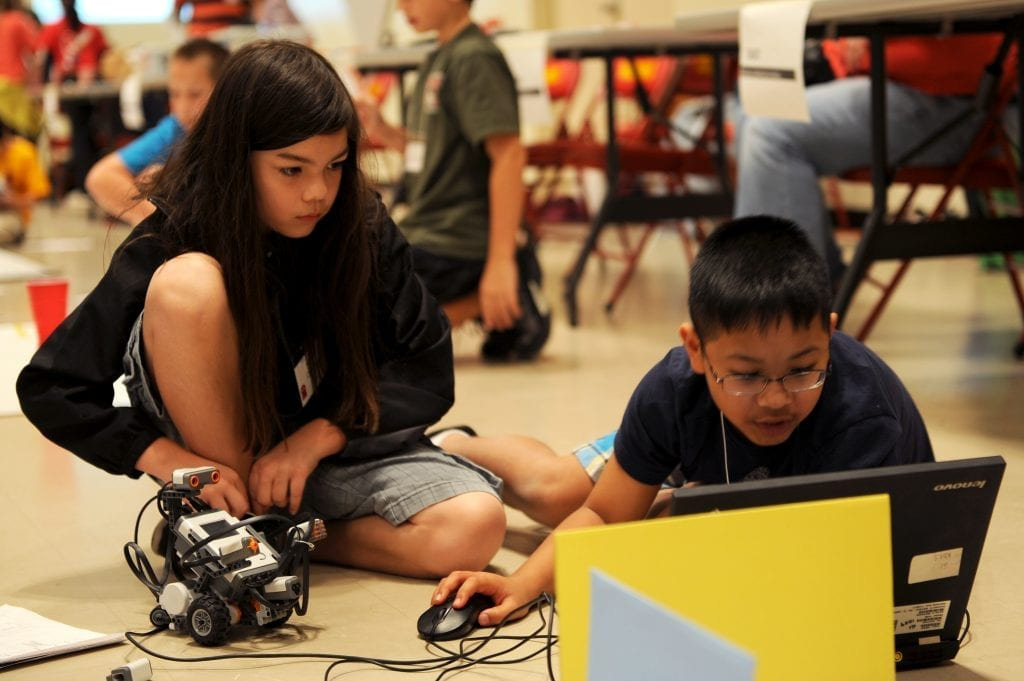 In robotics competitions, students are engaged in open-ended and authentic problem solving as they program a robot to navigate an obstacle course.
