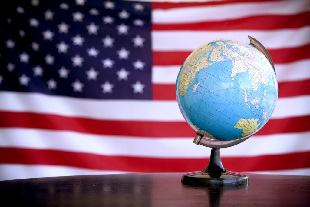 globe on an American flag, studio shot
