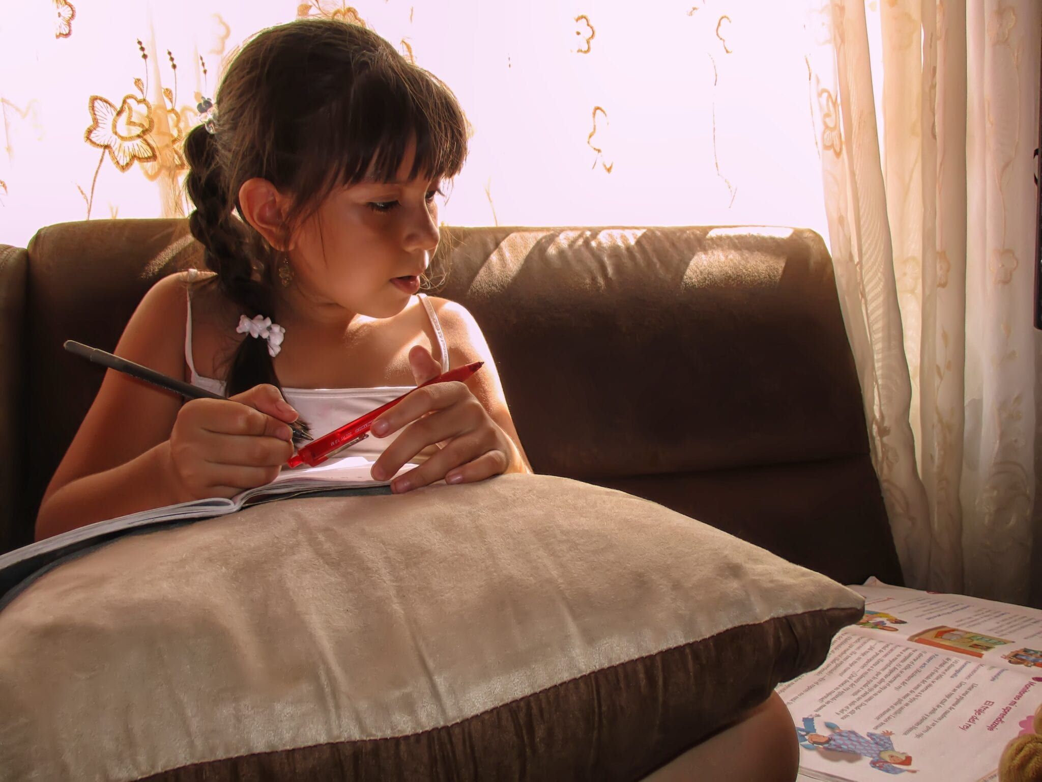 Girl doing at-home learning.