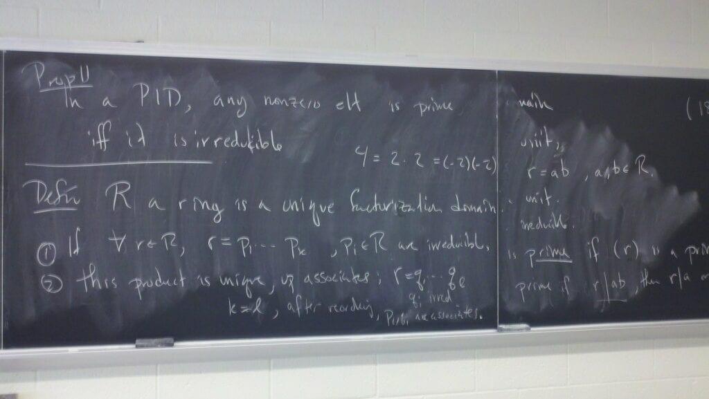 Algebra test equations on chalkboard.