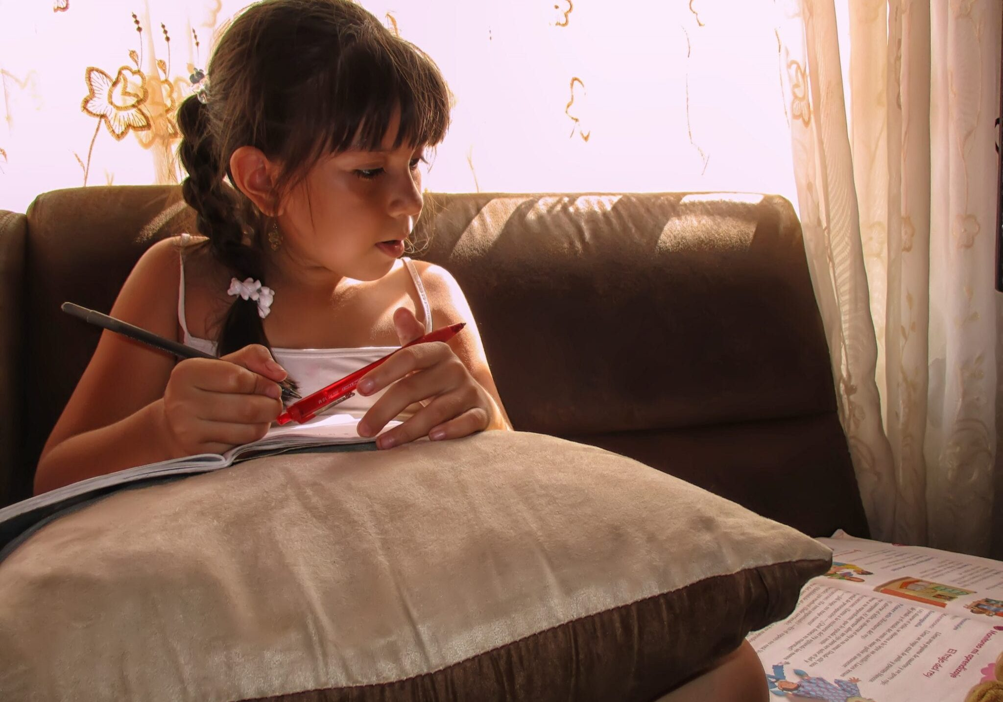 Girl studying at home.